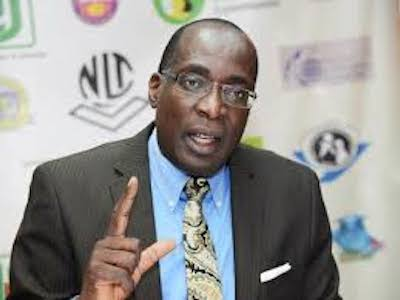 Ruel Reid charged with corruption; spends night in the slammer