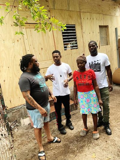 Rags 2 Riches label builds house for middle-aged woman in Grants Pen
